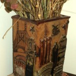 Clay vase with engraved pictures and 3D accents of New York City.