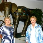 Joanne Gildea and Ruth Sylves posing in front of the massive elephant creation.