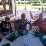 Patriotic residents enjoying the BBQ.