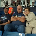 Jim Turchik, Terry Day and Kay Day clenching their seats during the game.