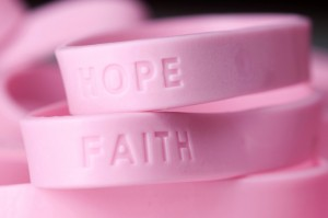Stock photo of pinks bracelets for breast cancer awareness.