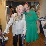 Staff member and a resident in their Sock Hop attire.