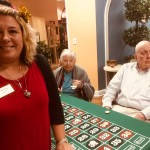 Community Life Assistant, Kristin Buswell, gambling with residents.