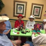 Residents sporting their best hats for the tea party.
