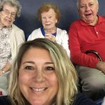 Community Life Assistant, Kristin Buswell, and residents enjoying the ballgame atmosphere.