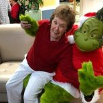 Resident Angie Raymond dancing with the Grinch.